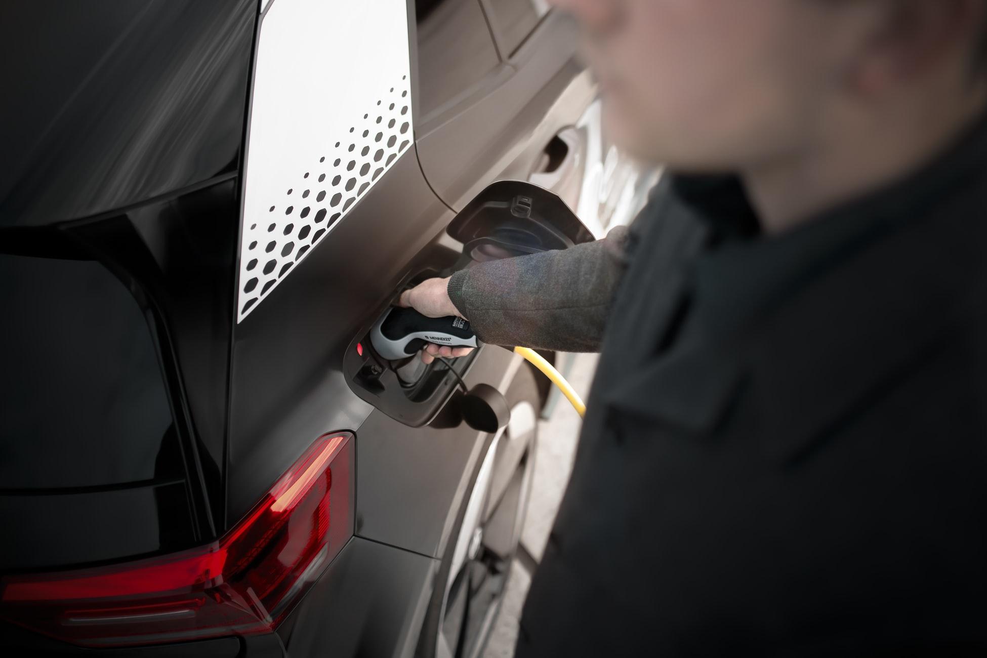 Man Charging Car UK