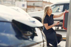 Woman Charging Car At Work
